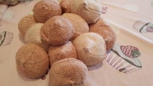 Pile of Knitted Knockers waiting to be gifted